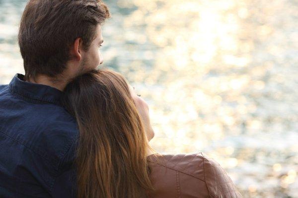 bigstock-Couple-Hugging-And-Watching-Su-82630544