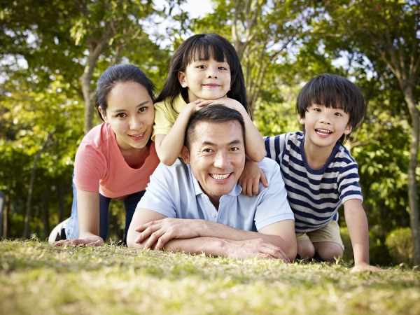 Happy Asian Family With Two Children