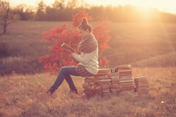 Hipster Girl Reading At Sunset
