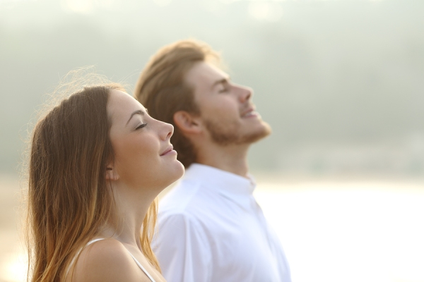 Couple Of Man And Woman Breathing Deep Fresh Air