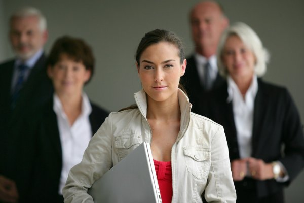 bigstock-An-intern-posing-with-her-supe-28892492